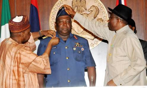 Picture of Alex Badeh being decorated as Defense Chief by former President Goodluck Jonathan and former National Security Adviser, Sambo Dasuki
