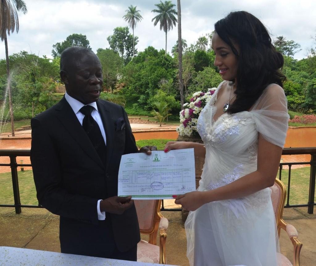 Adams Oshiomhole and Lara (wife) displaying their wedding certifcate