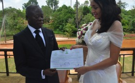 Adams Oshiomhole and Lara (wife) displaying their wedding certifcate